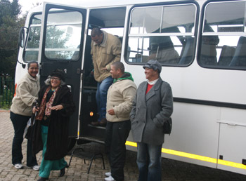 Elderly folk arrive from Mandela Day Tea Part at Harold Porter NBG
