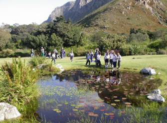 School children reflected in pond