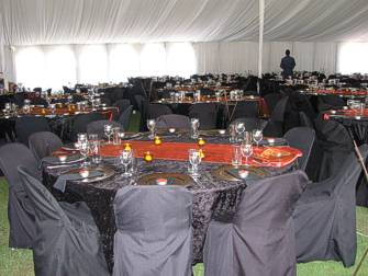 Table settings and decorations inside marquee tent