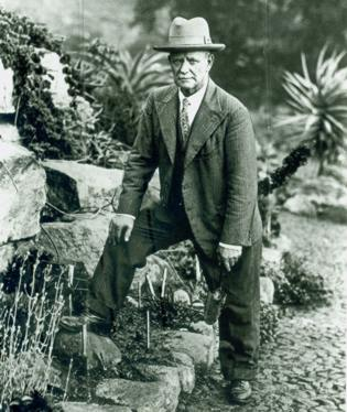 J W Mathews in rock garden named after him 1930s
